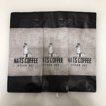 Matt-black-quad-seal-coffee-pouches-with