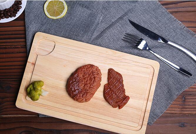 Cutting board still want to choose wood cutting board